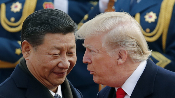 President Donald Trump chats with Chinese President Xi Jinping during a welcome ceremony in Beijing on Nov. 9. The Trump administration is expected to release the results of an investigation into Chinese trade practices, a move that could lead to sanctions.
